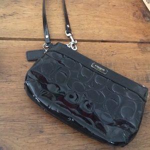 Coach wristlet zip bag. EUC. Black patent leather
